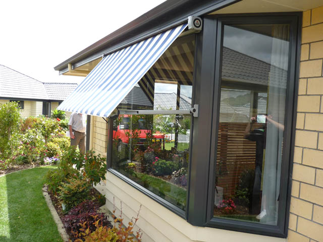 House awning over window extended